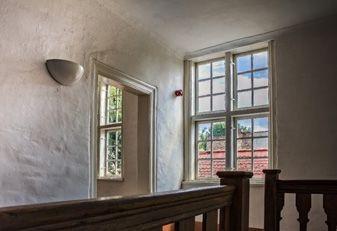 Sprossenfenster aus Holz oder Kunststoff